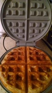 Oster CKSTWF1502-ECO review: waffle maker open to show cooked waffle
