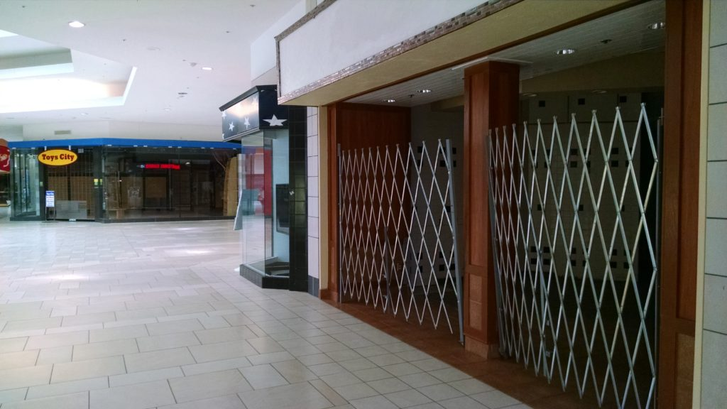 Closed stores near the former Macy's and Sears stores in Cary Towne Center